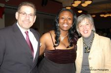 Ms. Baah poses with Mr and Mrs. Peri. Mr. Peri serves as the President of Junior Achievement of NY.