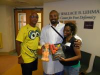 Alex and Makeda of The Sesame Workshop pose with Earl
