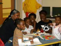 DTE volunteers color with children